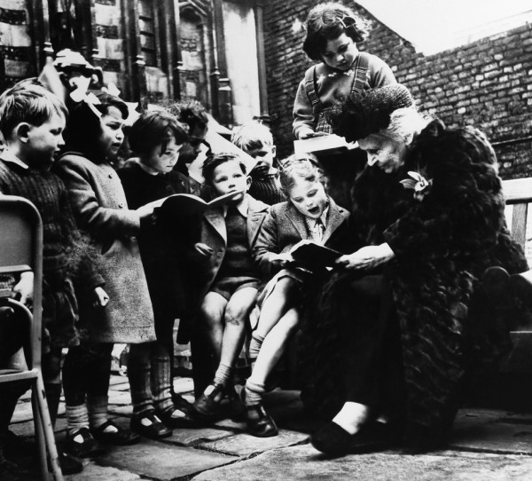 "Maria Montessori, Italian educator, with a large group of children from one of her ""works"" in Italy. (AP Photo)"